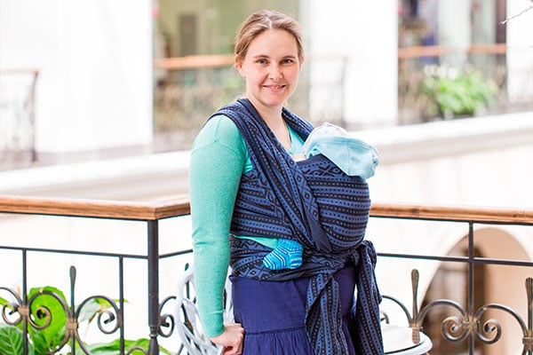 mom wearing a baby wrap to carry her baby