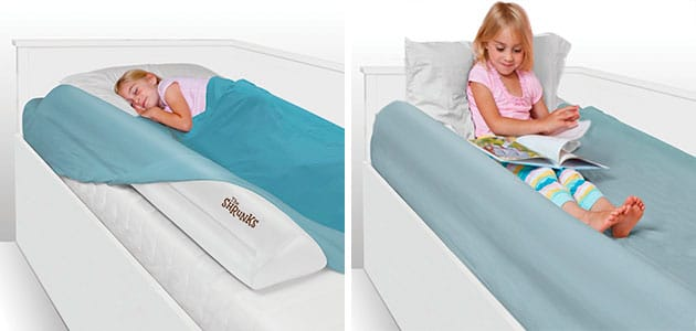padded toddler bed rail bumper sits under the sheets