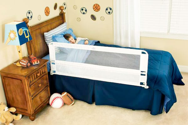toddler bed rail preventing toddler form falling out of bed