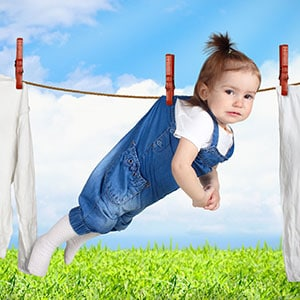 baby drying on washing line