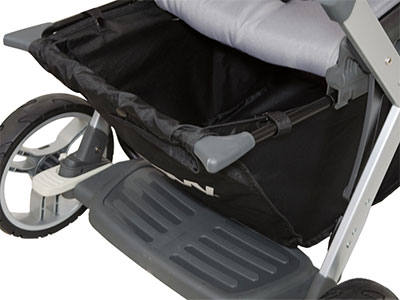 Extendable storage basket underneath the Joovy Caboose Sit and Stand Stroller
