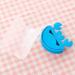 faucet rubber and plastic spout sitting on a checkered table cloth