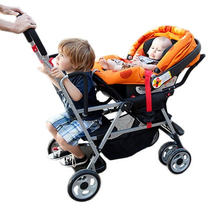 Joovy Kaboose sit and stand with young kid in the back and in car seat