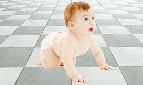baby crawling across tiles