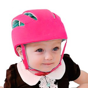 baby girl wearing a safety helmet on her head