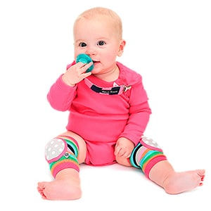 Baby girl wearing bright colored bella tunno happy knees