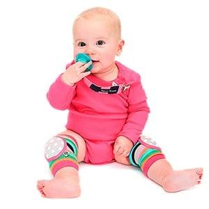 Baby girl wearing bright colored bella tunno happy knees