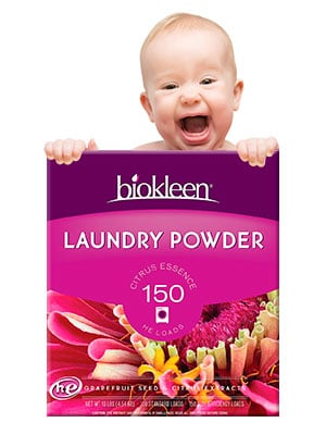 baby hiding behind a box of biokleen laundry powder