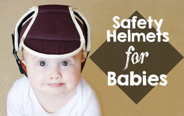baby wearing a safety helmet on his head