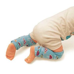 baby wearing leg warmers while crawling