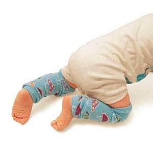 baby wearing leg warmers while crawling
