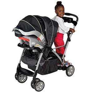 girl feeling a little cramped on sit and stand stroller with infant seat