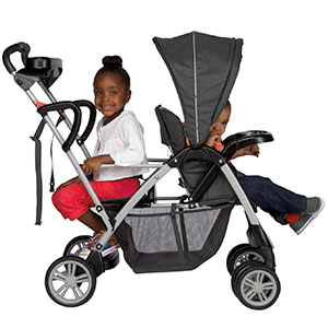 girl sitting down in the back of the graco room for 2 sit and stand stroller whole toddler sits up front