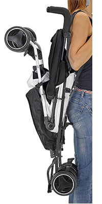 inglesina net umbrella stroller being carried over shoulder with carry strap