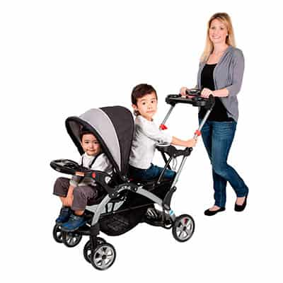 Mom pushing her two children in a sit and stand ultra