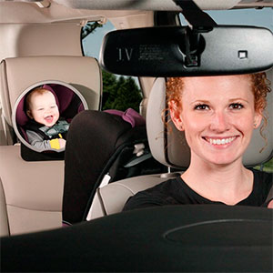 mom watching her baby while driving with a car mirror