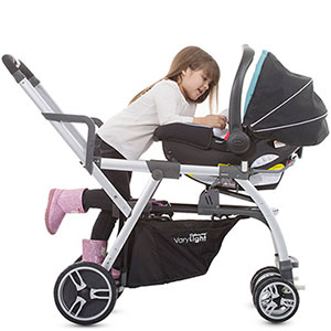 older girl in joovy caboose VaryLight sit and stand playing with baby in infant seat