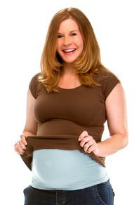 pregnant woman wearing belly band underneath shirt