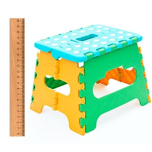 toddler step stool being measured with a ruler