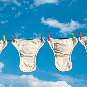 washed cloth diapers hanging on a line