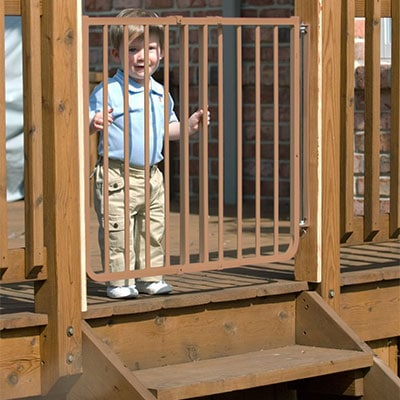 cardinal gates outdoor child safety gate with toddler standing behind