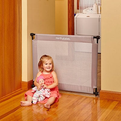 North States Portable Travel Baby Gate Installed In Kitchen