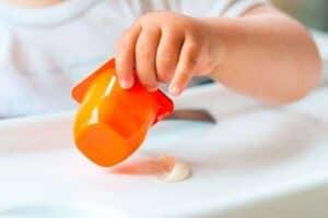 Baby eating a tub of yogurt