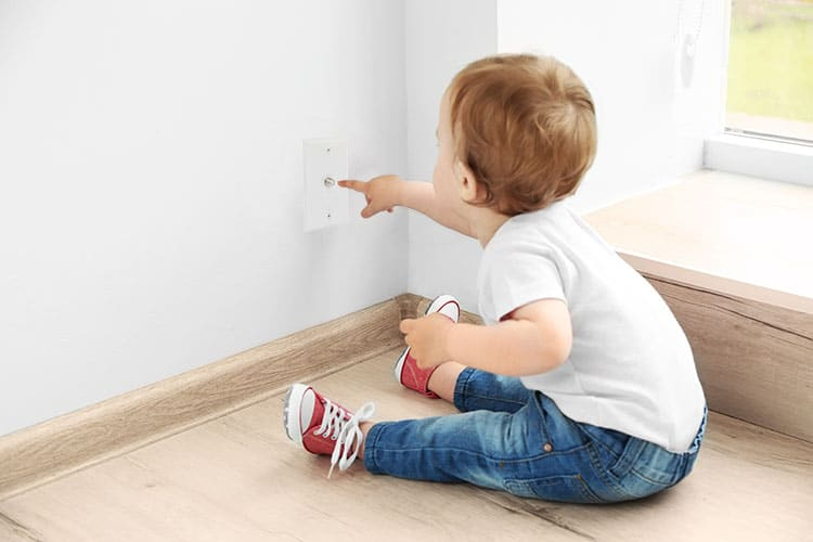 Baby playing with coaxial outlet