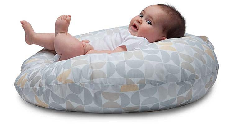 Baby in infant lounger side photo