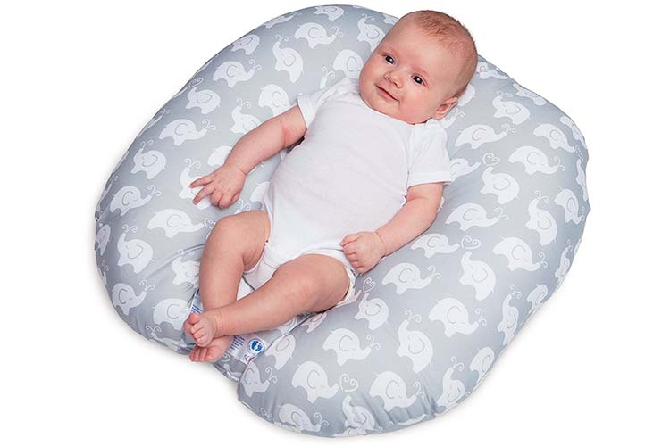 Baby resting in Boppy Newborn Lounger