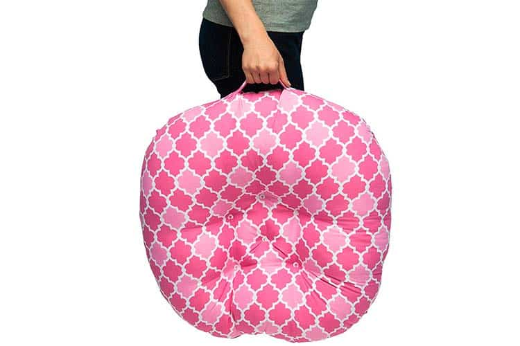 Boppy infant lounger carried by mom using handle