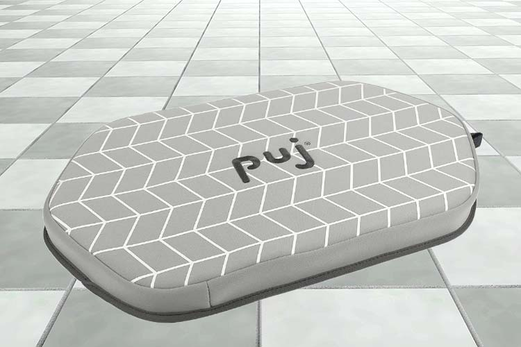 Puj Pad Bath Kneeler sitting on bathroom floor