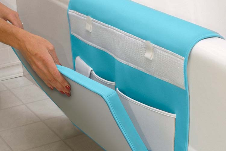 Woman folding up aquatopia deluxe easy kneeler on side of bath tub