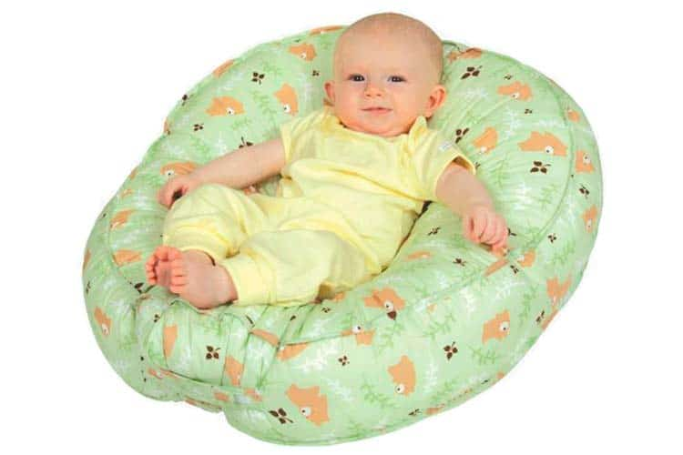 Baby reclining in leachco podster sling style infant lounger