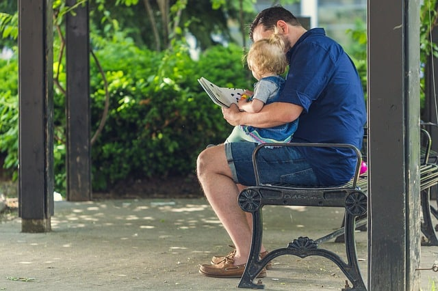 dad reading to baby parenting tips
