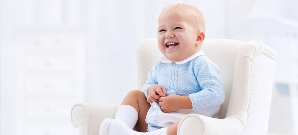 Toddler Sitting On Nursery Glider
