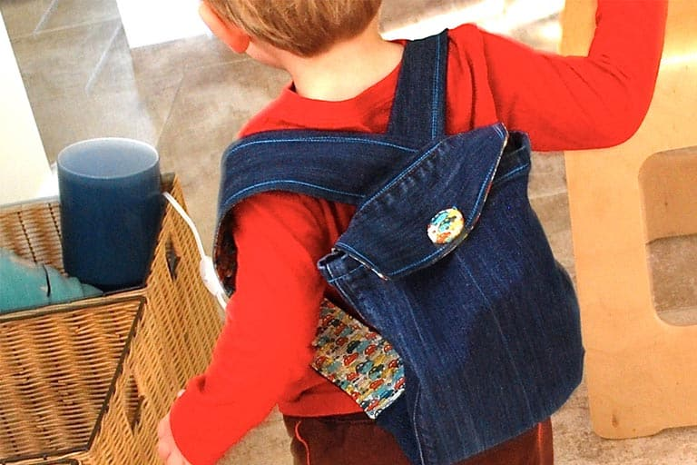 toddler with back pack