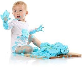 BAby shirt covered in blue paint