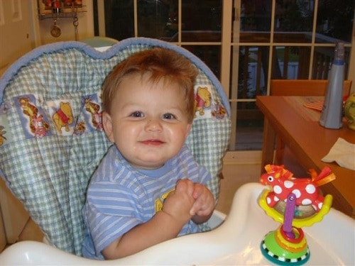 baby comfortably sitting in highchair