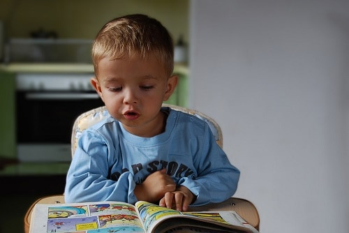 baby boy is reading