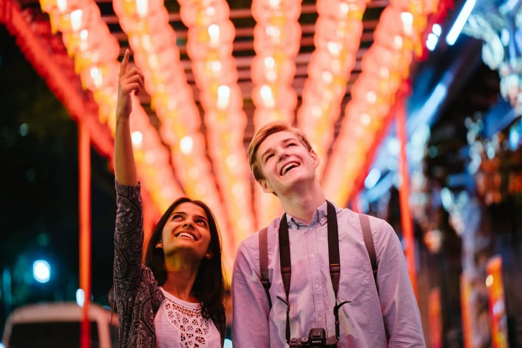 young couple happy while looking at the lights