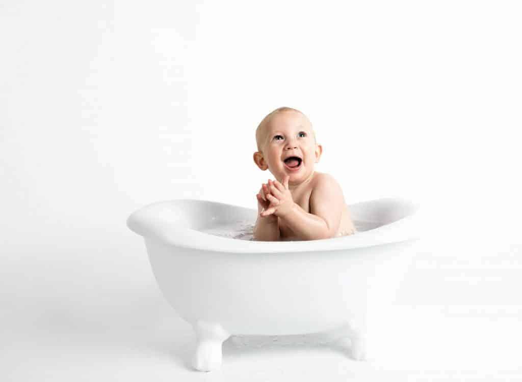 baby taking a bath on a tub