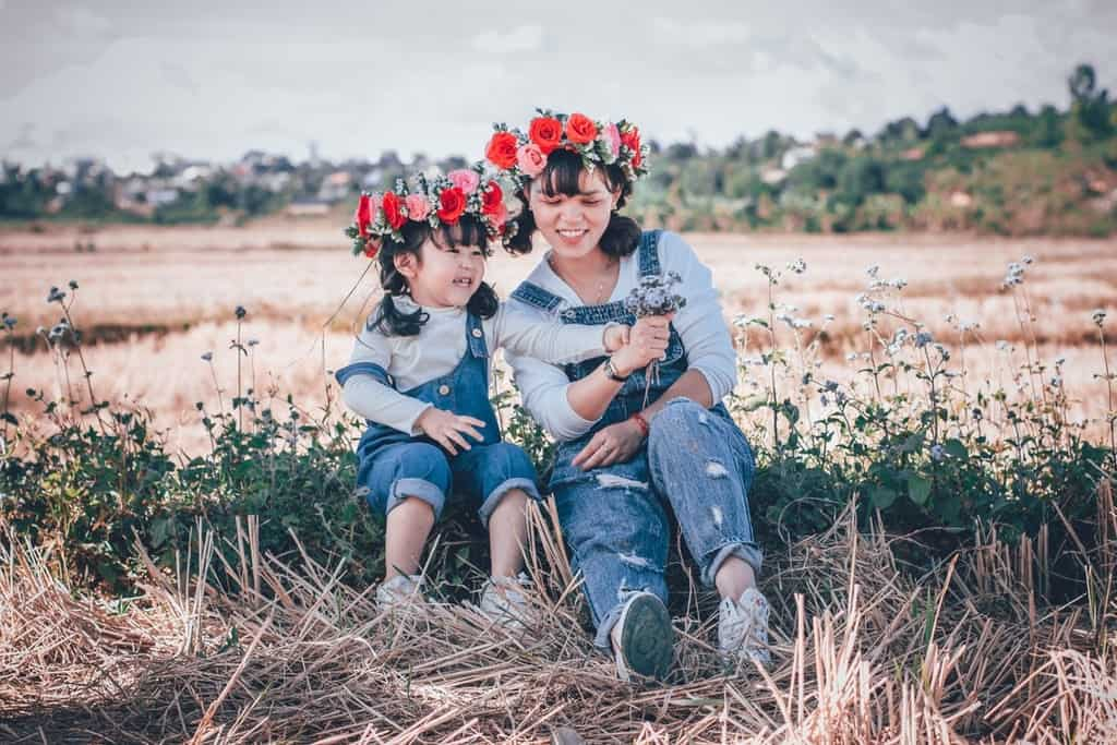 Mother and daughter having fun in the fields