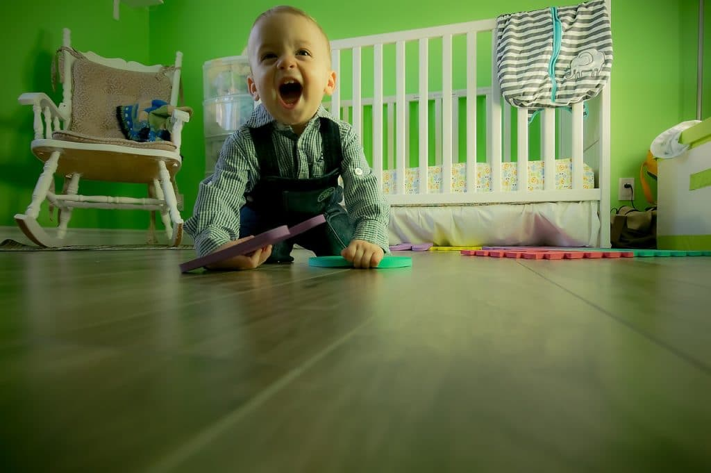 Baby boy sitting on the floor