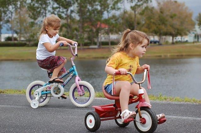 two girls riding their bikes