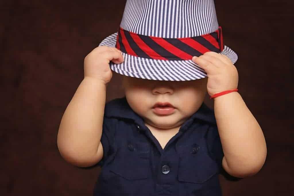 Baby wearing fedora hat