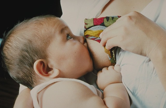mom breastfeeding baby