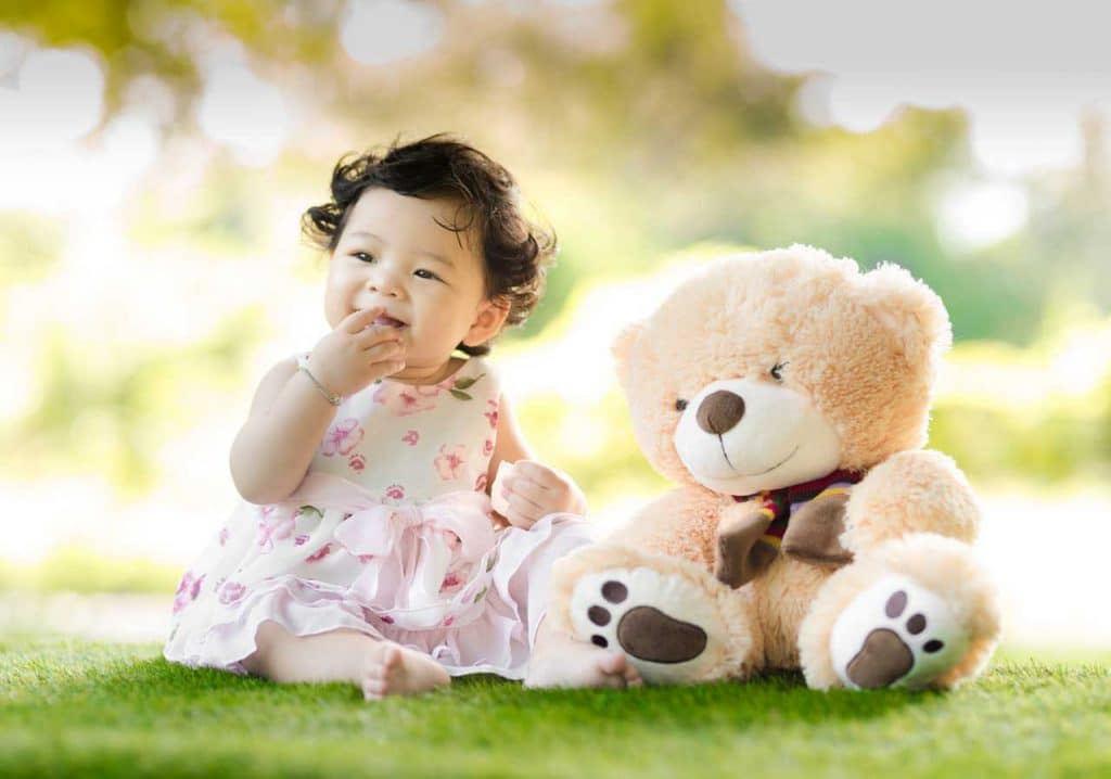 baby girl and a teddy bear