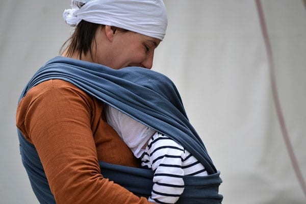 baby sling with her mother