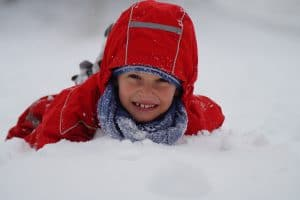 Smiling girl is wearing the best baby snowsuit